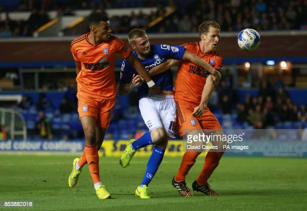 Birmingham City's Denny Johnstone is blocked by Ipswich Town's Christophe Berra and Tyrone Mings during the Sky Bet Championship match at St Andrews...
