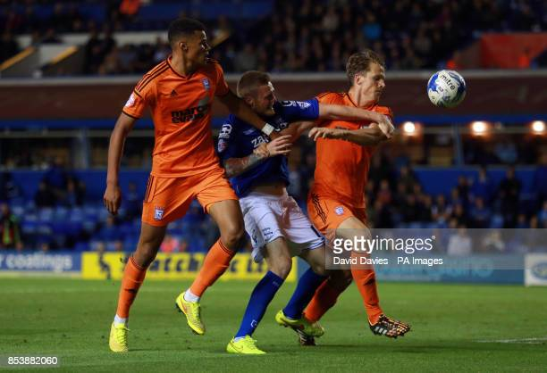 Birmingham City's Denny Johnstone is bloked by Ipswich Town's Christophe Berra and Tyrone Mings during the Sky Bet Championship match at St Andrews...