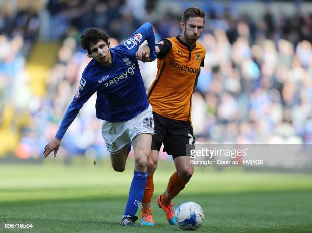 Birmingham City's Diego Fabbrini and Wolverhampton Wanderers' James Henry battle for the ball