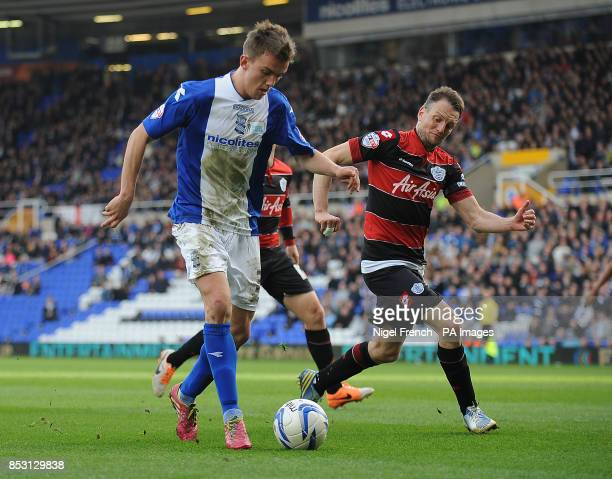 Birmingham City's Emyr Huws and Queens Park Rangers Clint Hill battle for the ball during the Sky Bet Championship match at St Andrews Birmingham