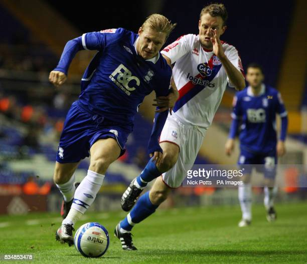 Birmingham City's Garry O'Connor holds off a challenge from Crystal Palace's Clint Hill during the CocaCola Championship match at St Andrews...