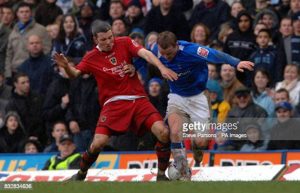 Birmingham City's Gary McSheffrey battles with Cardiff City's Kevin McNaughton during the CocaCola Championship match at St Andrews Birmingham