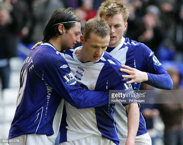 Birmingham City's Gary McSheffrey celebrates scoring his sides third goal of the game from the penalty spot with teammates Sebastian Larsson and...