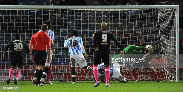 Birmingham City's Jack Butland makes a save from Huddersfield Town's Jermaine Beckford in added time during the npower Football League Championship...