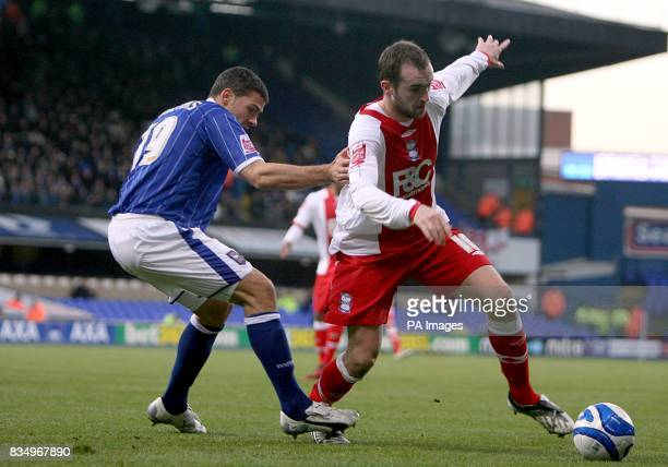 Birmingham City's James McFadden and Ipswich Town's Jonathan Walters battle for the ball