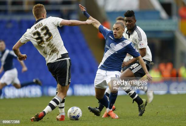 Birmingham City's James Vaughan and Fulham's Dan Burn battle for the ball