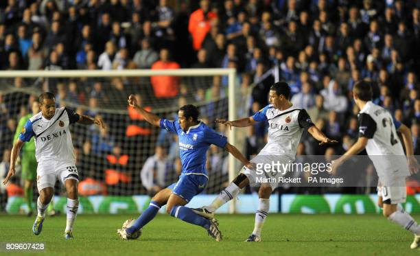 Birmingham City's Jean Beausejour battles for the ball with Club Brugge's Vadis Odjidja and Nabil Dirar during the UEFA Europa League match at St...