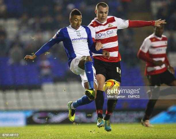 Birmingham City's Jesse Lingard and Doncaster Rovers' Luke McCullough battle for the ball