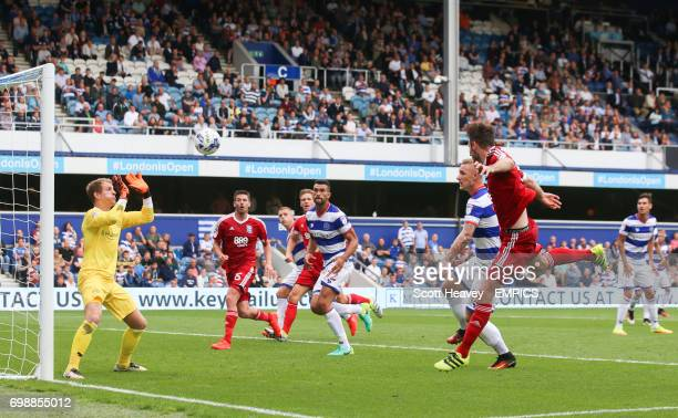 Birmingham City's Jonathan Grounds has a a header saved by Queens Park Rangers Alex Smithies