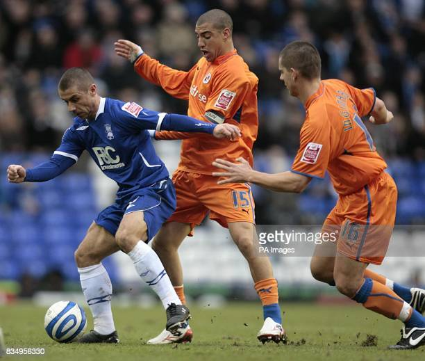 Birmingham City's Kevin Phillips in action with Reading's James Harper and Ivar Ingimarsson