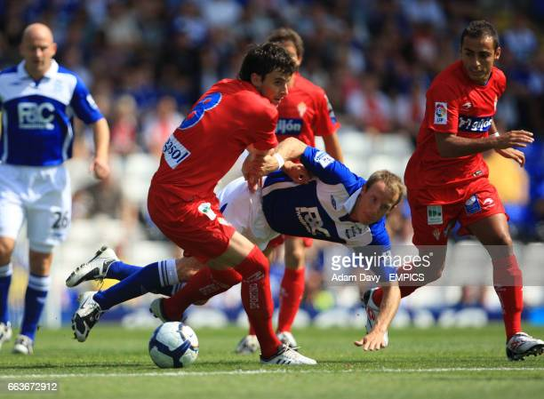 Birmingham City's Lee Bowyer and Real Sporting de Gijon's Miguel Michel battle for the ball