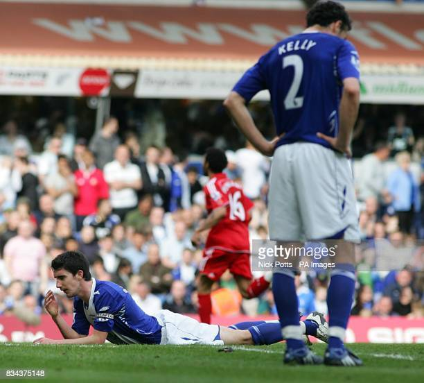 Birmingham City's Liam Ridgewell and Stephen Kelly stand dejected after Liverpool's Yossi Benayoun head's in the second goal 22