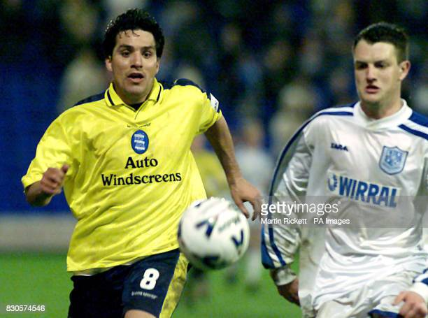 Birmingham City's Marcelo Cipriano chases the ball with Tranmere Rovers' Clint Hill during their First Division football match at Prenton Park in...