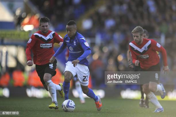 Birmingham City's Nathan Redmond and Huddersfield Town's Adam Clayton and Oliver Norwood