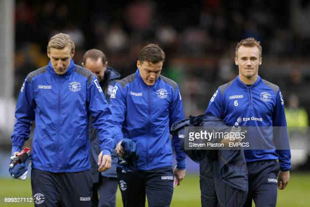 Birmingham City's Nicolai BrockMadsen Shane Lowry and Maikel Kieftenbeld make their way out for the start of the game