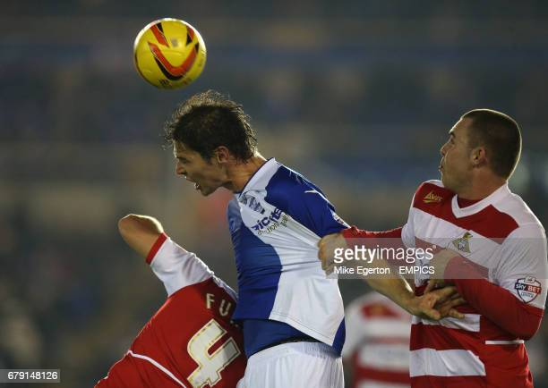 Birmingham City's Nikola Zigic and Doncaster Rovers' Dean Furman and Luke McCullough battle for the ball in the air