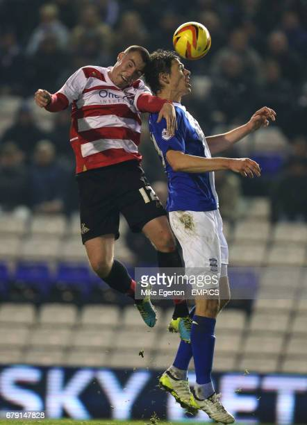 Birmingham City's Nikola Zigic and Doncaster Rovers' Luke McCullough battle for the ball in the air