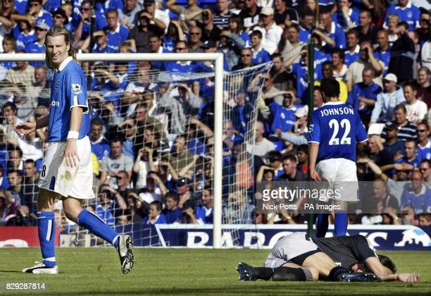 Birmingham City's Robbie Savage looks back at the floored Chelsea striker Mateja Kezman during their FA Barclays Premiership match at St Andrews...