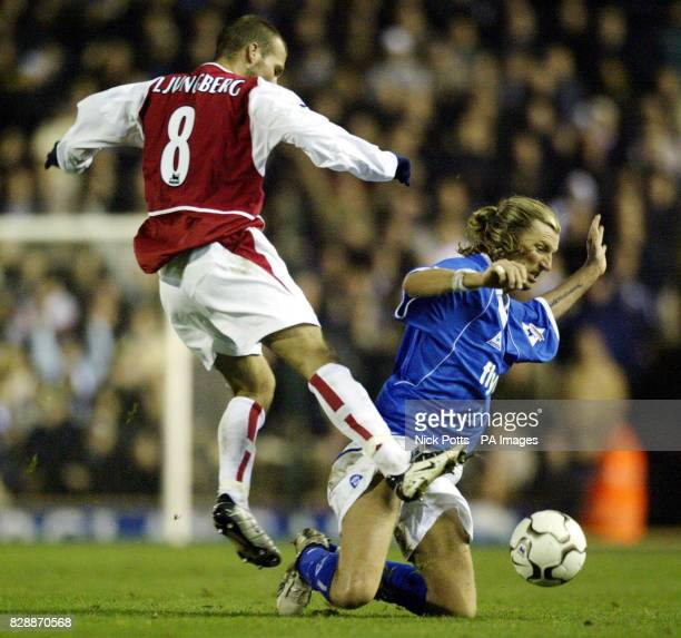 Birmingham City's Robbie Savage slides on his knees to tackle Arsenal's Fredrik Ljungberg during their FA Barclaycard Premiership match at...