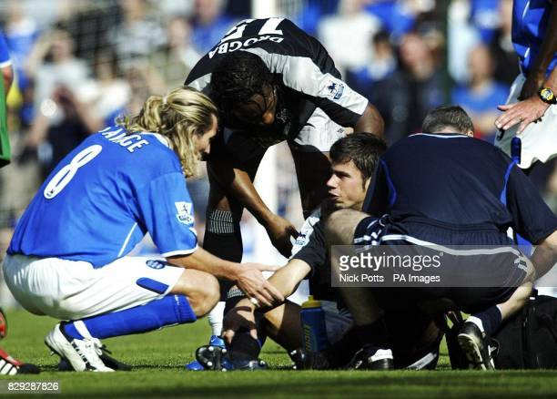 Birmingham City's Robbie Savage talks and shakes the hand of the floored Chelsea striker Mateja Kezman after an incident during their FA Barclays...