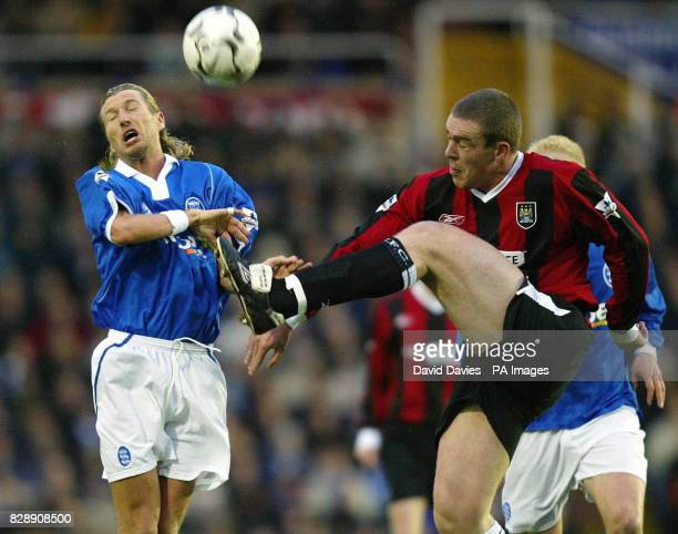 Birmingham City's Robbie Savage tries to block a clearence by Richard Dunne of Manchester City during Birmingham's 21 victory in the Barclaycard...