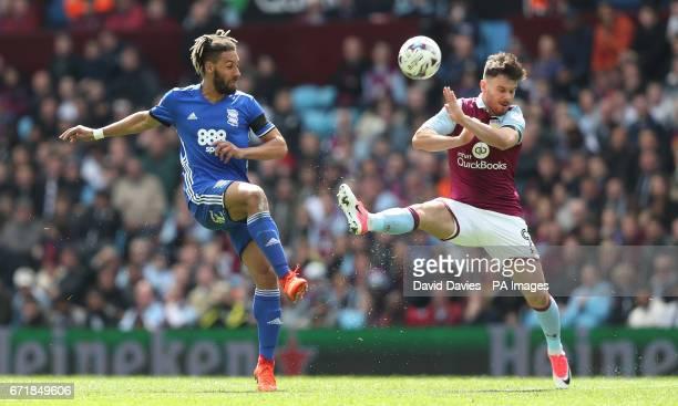 Birmingham City's Ryan Shotton is challenged by Aston Villa's Scott Hogan during the Sky Bet Championships match at Villa Park Birmingham