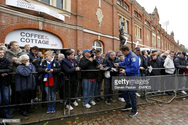 Birmingham City's Shane Lowry signs autographs for fans as he arrives at the ground