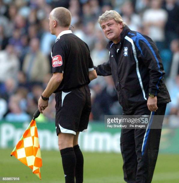 Birmingham City's Steve Bruce speaks with a linesman during the Barclays Premier League match at The City of Manchester Stadium Manchester