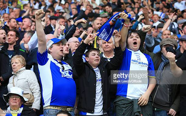 Birmingham fans celebrate avoiding relegation following the Sky Bet Championship match between Bolton Wanderers and Birmingham City at the Reebok...