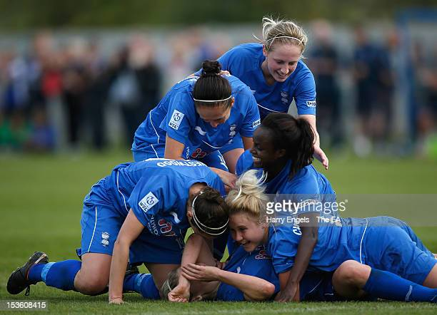 Birmingham players mob teammate Emily Simpkins after she scored her side's first goal during the FA Women's Super League match between Birmingham...