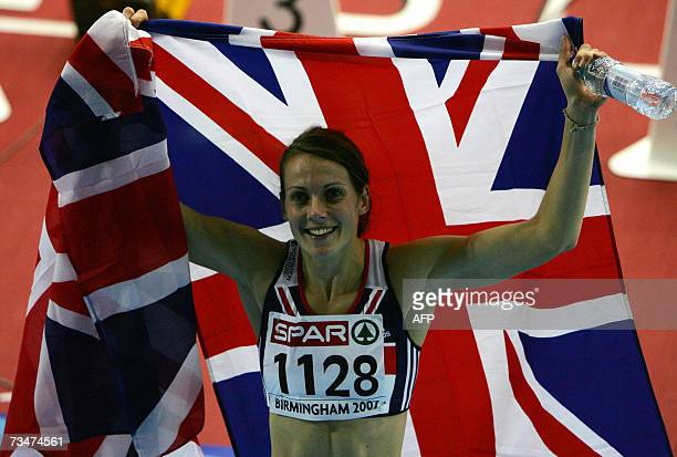 British Kelly Sotherton celabrates with her national flag at the end of the 800m pentathlon 02 March 2007 during the 29th European Athletics Indoor...