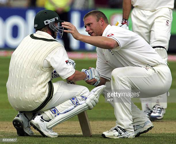 Englands Andrew Flintoff consoles Australian Brett Lee after England beat Australia by just two runs to win the Second Test at Edgbaston cricket...