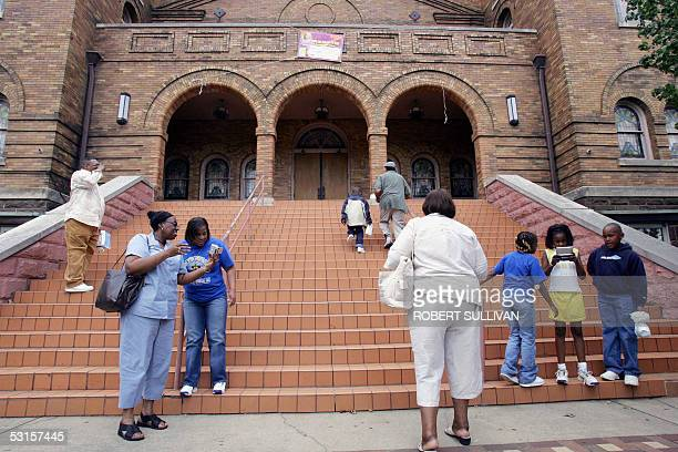 TO GO WITH AFP STORYUSRACE A church group from Georgia stop for pictures on the front steps of the 16th Street Bapist Church 21 May 2005 ithe Civil...