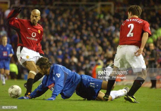 Birmingham's Christophe Dugarry is floored by Manchester United's Juan Veron and Gary Neville during their FA Barclaycard Premiership match at...