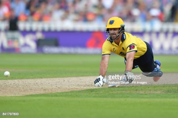 Birmingham's Colin de Grandhomme dives to avoid a run out during the NatWest T20 Blast Finals Day at Edgbaston Birmingham