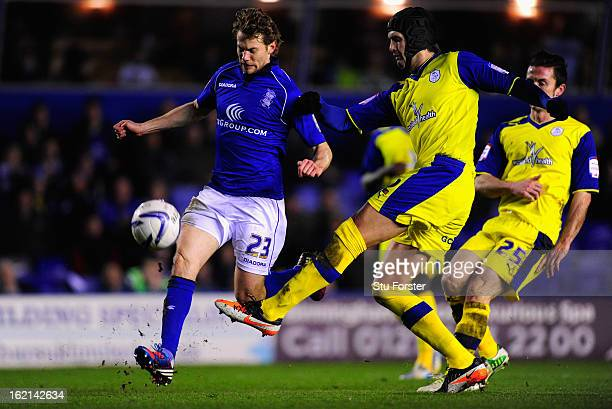 Birminham player Jonathan Spector is challenged by Sheff Wed defender Miguel Llera during the npower Championship match between Birmingham City and...