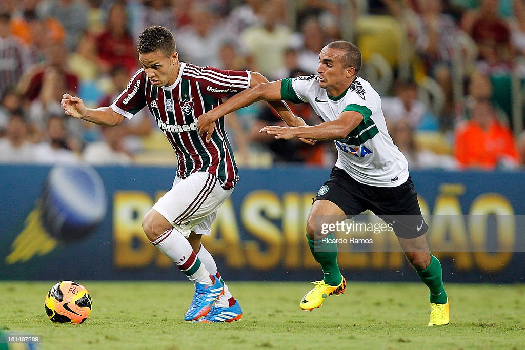Biro Biro of Fluminense fights for the ball with Gil of Coritiba during the match between Fluminense and Coritiba for the Brazilian Series A 2013 at Maracana on September 21, 2013 in Rio de Janeiro, Brazil.