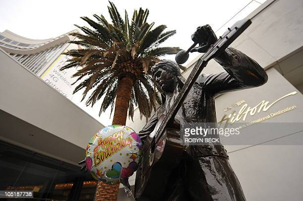 A birthday balloon is attached to the statue of Elvis Presley in front of the Las Vegas Hilton in Las Vegas on what would have been 'the King's' 75th...