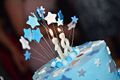 Birthday blue cake with candle