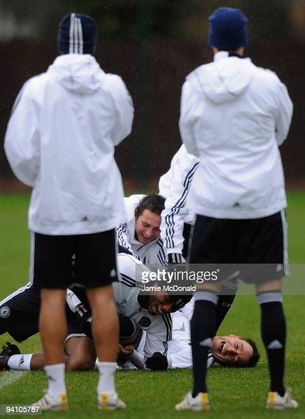 Birthday Boy John Terry of Chesea is forced to the ground by team mates Didier Drogba and Frank Lampard during a Chelsea training session ahead of...