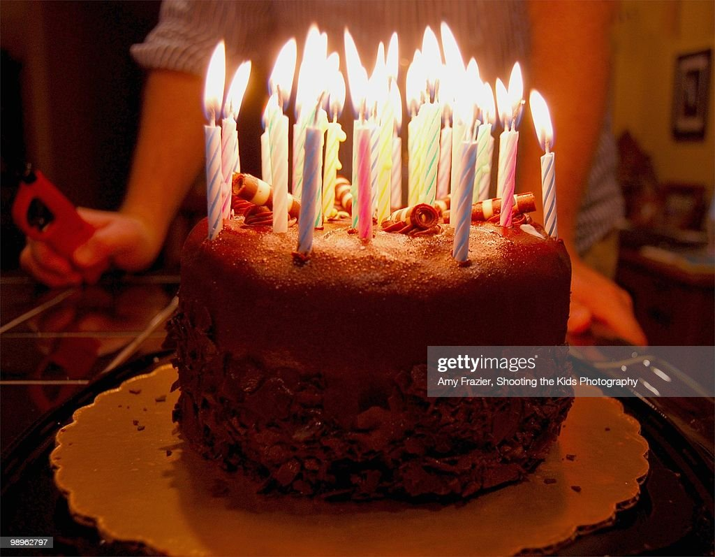 A Birthday Cake Ablaze With Many Candles Foto de stock ...