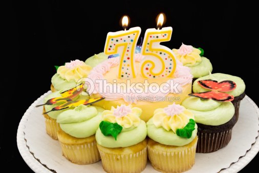 Birthday Cake And Cupcakes With A Number 75 Burning Candle Stock Photo