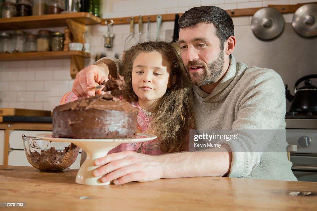 Birthday cake baking with daddy : Stock Photo