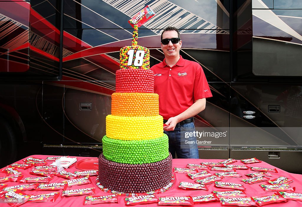 A birthday cake is presented to Kyle Busch, driver of the #18 Skittles Marvel Toyota, prior to the NASCAR Sprint Cup Series GEICO 500 at Talladega Superspeedway on May 1, 2016 in Talladega, Alabama.
