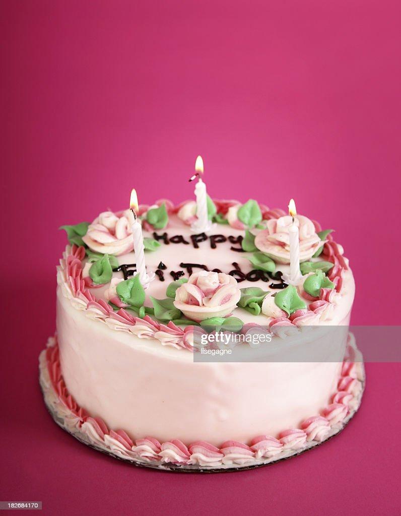 Birthday cake on pink : Stock Photo