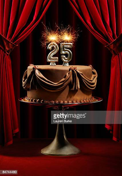 Birthday Cake on Stage with Number 25 Candles