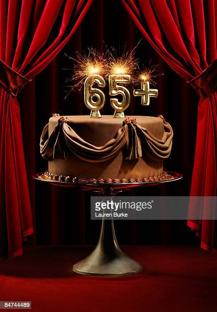 Birthday Cake on Stage with Number 65 Candles