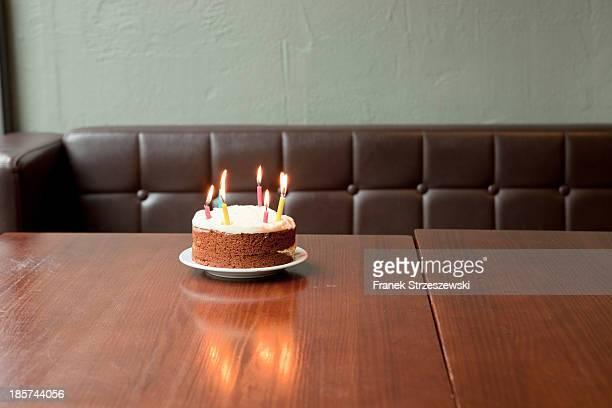 Birthday cake on table in restaurant