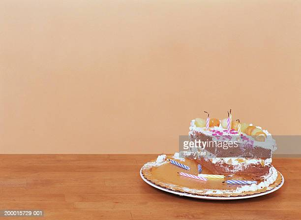 Birthday cake on tray with blown out candles