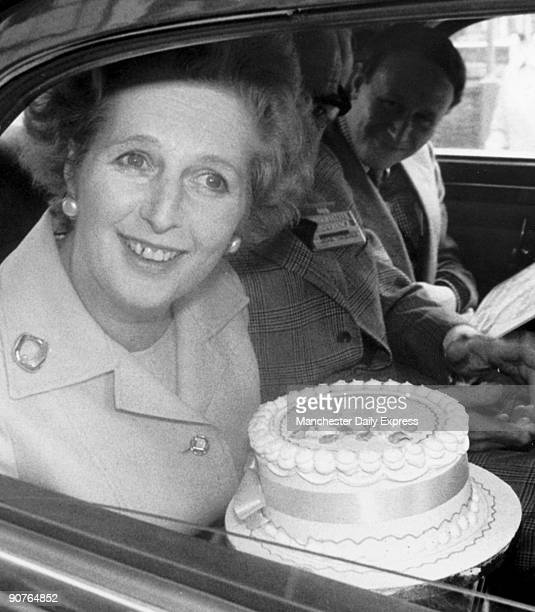 �Birthday cake smile from Mrs T as she holds a cake with no candles presented by Young Tories at the Conservative Party Conference�